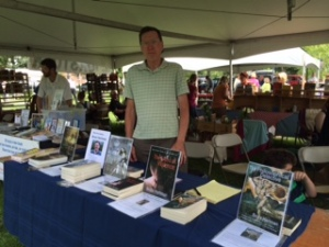Bruce Hartman selling his books at Bookstock, July 2014.