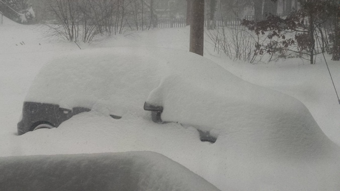 9:20 a.m. Southern NH - my poor son may not see his car again until the spring thaw.