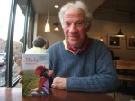 Peter Gould holding a copy of Marley, his new book.