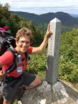 Deborah Lee Luskin at the US-Canadian border marker 592.